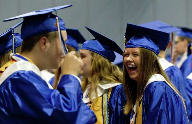 Elise Hogelin shares a laugh as she waits for the start of the Oak Ridge High School graduation ceremony at Cynthia Woods Mitchell Pavilion, Tuesday, May 28, 2019, in The Woodlands. Photo: Jason Fochtman, Houston Chronicle / Staff Photographer / © 2019 Houston Chronicle