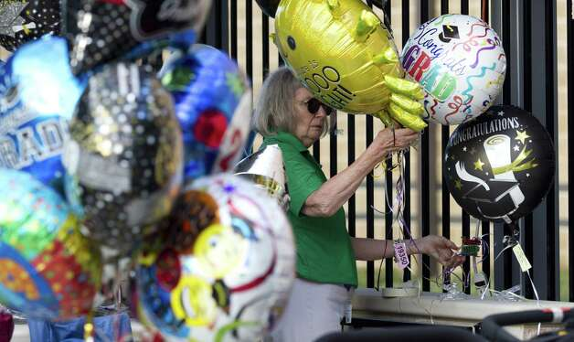 Volunteer Barbara Chambers organizes graduation balloons during a graduation ceremony for Oak Ridge High School at Cynthia Woods Mitchell Pavilion, Tuesday, May 28, 2019, in The Woodlands. Photo: Jason Fochtman, Houston Chronicle / Staff Photographer / © 2019 Houston Chronicle