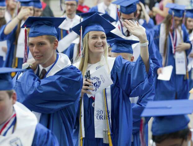 A student waves to family and friends during a graduation ceremony for Oak Ridge High School at Cynthia Woods Mitchell Pavilion, Tuesday, May 28, 2019, in The Woodlands. Photo: Jason Fochtman, Houston Chronicle / Staff Photographer / © 2019 Houston Chronicle