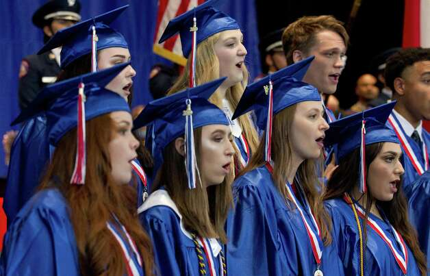 Members of the Oak Ridge High School choir sing the national anthem during the school's graduation ceremony at Cynthia Woods Mitchell Pavilion, Tuesday, May 28, 2019, in The Woodlands. Photo: Jason Fochtman, Houston Chronicle / Staff Photographer / © 2019 Houston Chronicle