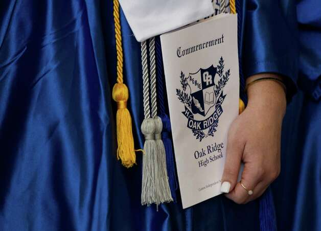 A student holds a program during a graduation ceremony for Oak Ridge High School at Cynthia Woods Mitchell Pavilion, Tuesday, May 28, 2019, in The Woodlands. Photo: Jason Fochtman, Houston Chronicle / Staff Photographer / © 2019 Houston Chronicle