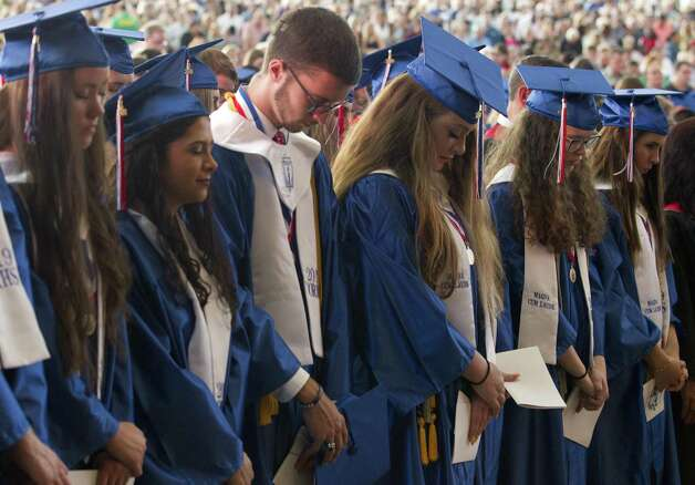Students pray during a graduation ceremony for Oak Ridge High School at Cynthia Woods Mitchell Pavilion, Tuesday, May 28, 2019, in The Woodlands. Photo: Jason Fochtman, Houston Chronicle / Staff Photographer / © 2019 Houston Chronicle
