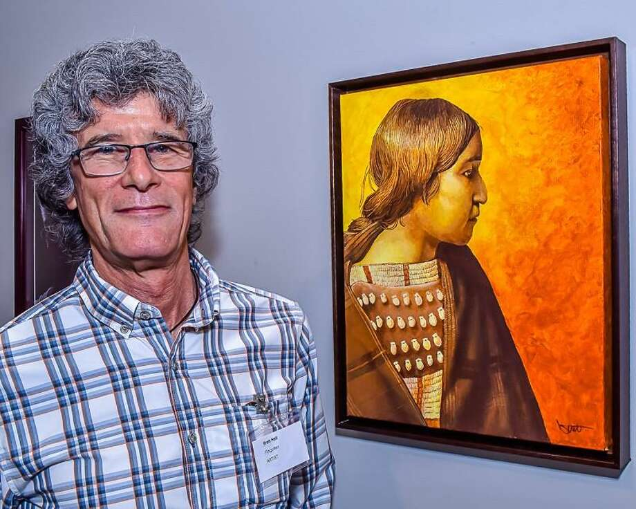 "Pictured is artist Brett Hall with his artwork ""Forgotten,"" an acrylic on canvas. The artwork was the 2nd place in the Acrylic Division at the 34th Annual Texas and Neighbors Art Exhibition, Irving, Texas. Photo: Courtesy Photo"