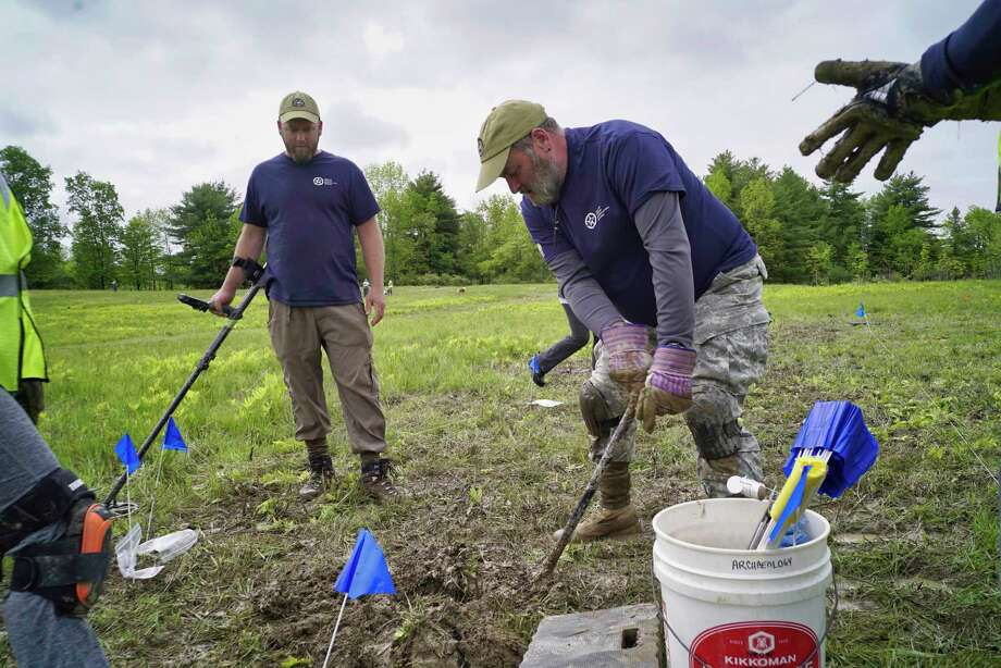 Army veteran, Greg Ashcroft, left, from Smithfield, Utah, and Marine Corps/ Army veteran Kevin McMahon, from Old Lyme, CT,  take part in an archaeological survey of the Barber's wheat field at the Saratoga National Historical Park, on Wednesday, May 29, 2019, in Stillwater, N.Y. Veterans with American Veterans Archaeological Recovery (AVAR) along with students from Sacred Heart University and National Park Service staff are taking part in the dig to find artifacts. Barber's wheat field was the site of the second battle of Saratoga that took place on Oct. 7, 1777.    (Paul Buckowski/Times Union) Photo: Paul Buckowski, Albany Times Union / (Paul Buckowski/Times Union)