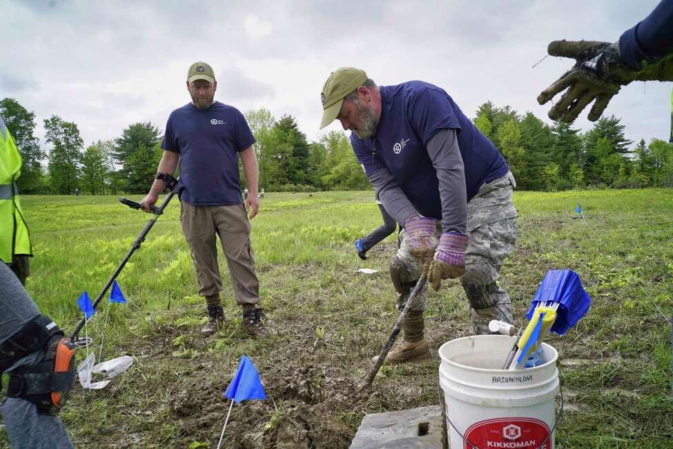 Army veteran, Greg Ashcroft, left, from Smithfield, Utah, and Marine Corps/ Army veteran Kevin McMahon, from Old Lyme, CT, take part in an archaeological survey of the Barber's wheat field at the Saratoga National Historical Park, on Wednesday, May 29, 2019, in Stillwater, N.Y. Veterans with American Veterans Archaeological Recovery (AVAR) along with students from Sacred Heart University and National Park Service staff are taking part in the dig to find artifacts. Barber's wheat field was the site of the second battle of Saratoga that took place on Oct. 7, 1777. (Paul Buckowski/Times Union)