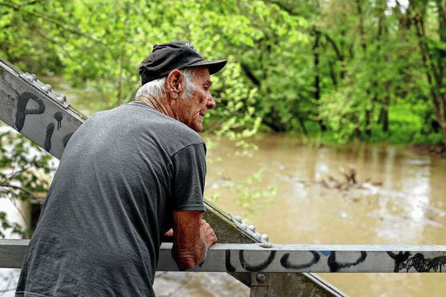 In this photo taken May 8, 2019, Elmer Sullivan checks out high water in the Fishing River in the small community of Mosby, Mo. Sullivan and nearly half of the homeowners in Mosby signed up in 2016 for a program in which the government would buy and then demolish their properties rather than paying to rebuild them over and over. They're still waiting for offers, joining thousands of others across the country in a slow-moving line to escape from flood-prone homes. Photo: Charlie Riedel | AP