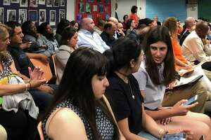 A packed crowd gathered in the Stamford Government Center on May 29 for a meeting of the Stamford Board of Education.