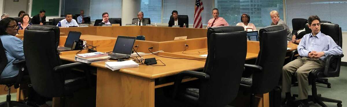 Members of the Stamford Board of Education listened to a speaker during public comment at the board's May 29 meeting in the Stamford Government Center.