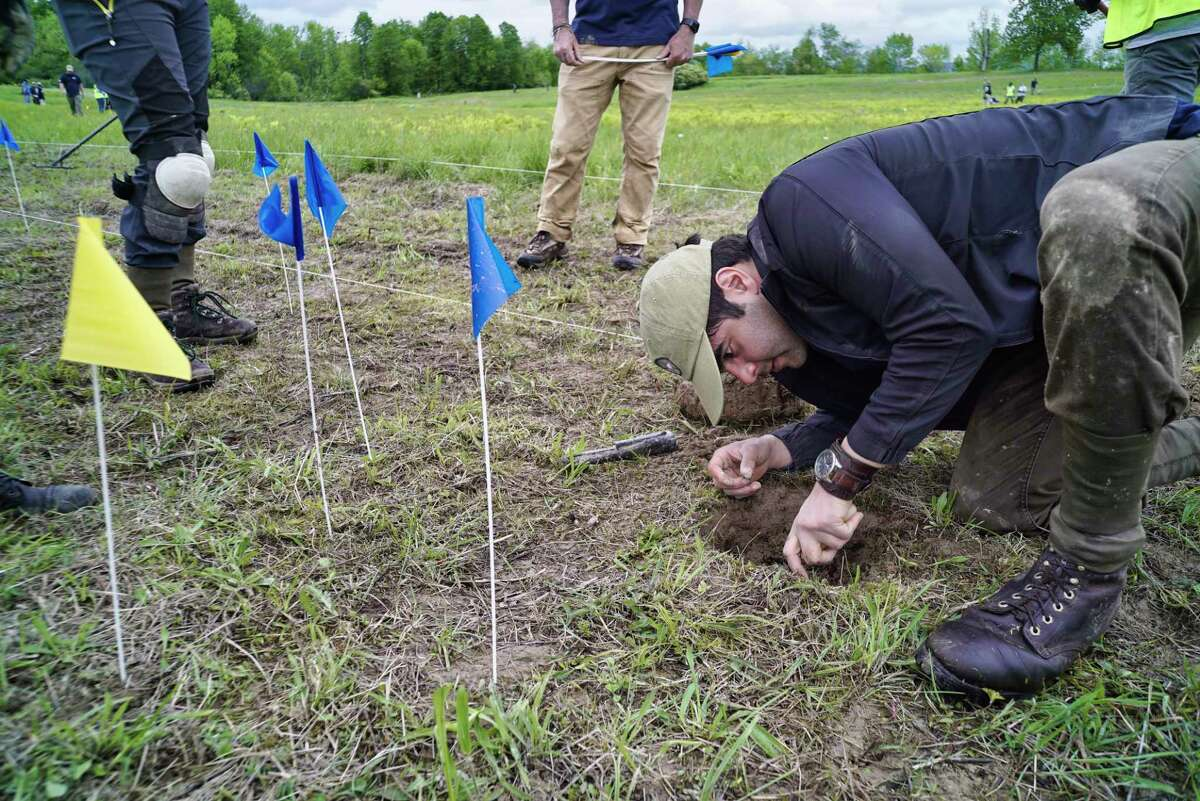 Army veteran Zeth Lujan from Rochester, N.Y., digs into a spot to find an artifact during an archaeological survey of the Barber's wheat field at the Saratoga National Historical Park, on Wednesday, May 29, 2019, in Stillwater, N.Y. Veterans with American Veterans Archaeological Recovery (AVAR) along with students from Sacred Heart University and National Park Service staff are taking part in the dig to find artifacts. Barber's wheat field was the site of the second battle of Saratoga that took place on Oct. 7, 1777. (Paul Buckowski/Times Union)
