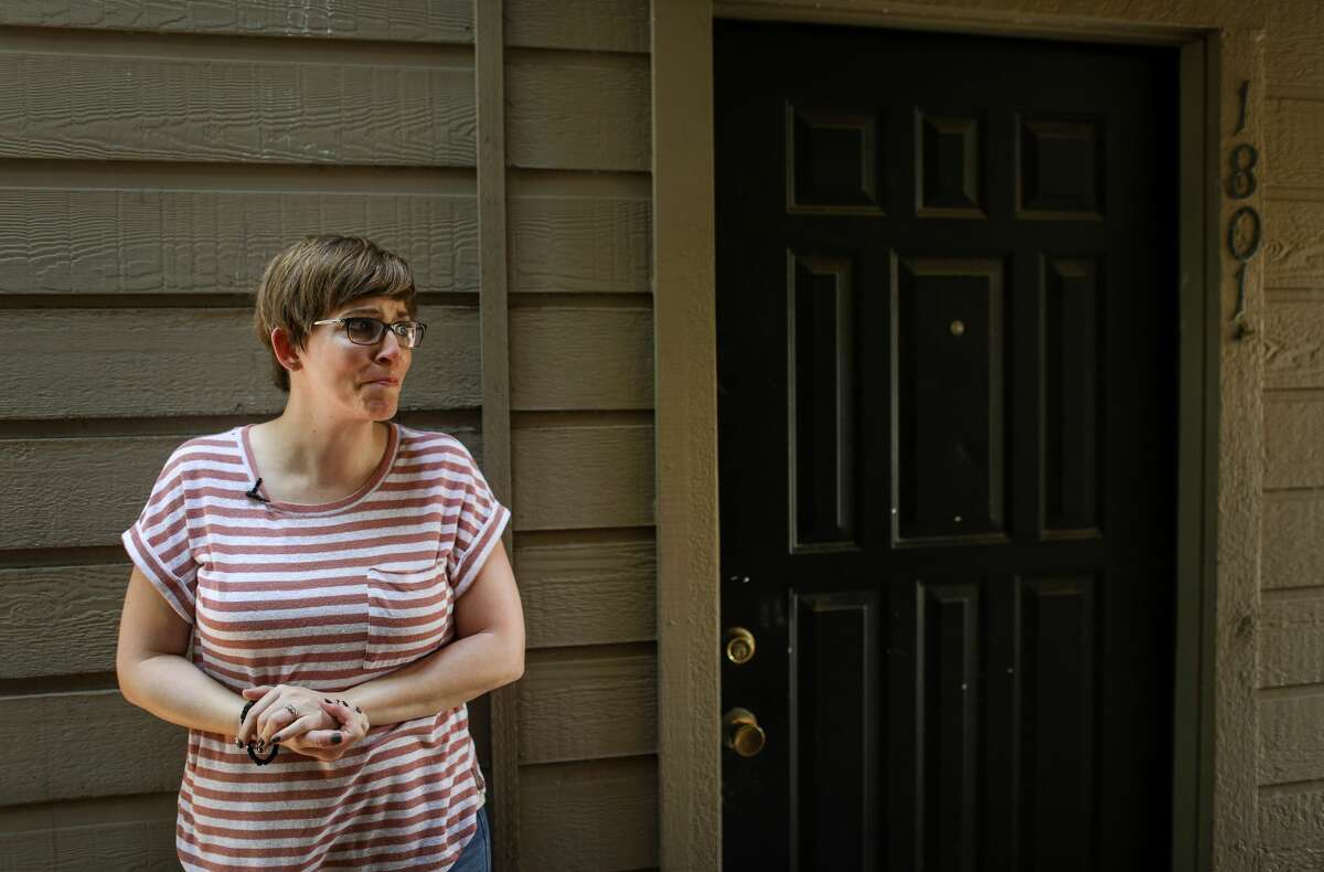 Anne Marie Miller cries outside of an apartment where she says she was sexually abused by Mark Aderholt, who went on to become one of the top missionaries with the International Mission Board.