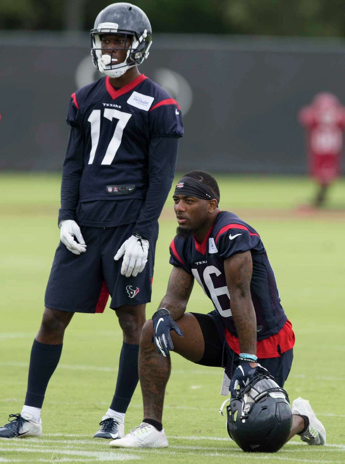 Wide receivers Vyncint Smith (17) and Keke Coutee (16) watch their teammates doing drills during Houston Texans OTA's at the Houston Methodist Training Center on Wednesday, May 29, 2019, in Houston.