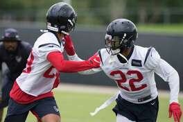 Cornerbacks Xavier Crawford (28) and Aaron Colvin (22) work on a drill during Houston Texans OTA's at the Houston Methodist Training Center on Wednesday, May 29, 2019, in Houston.