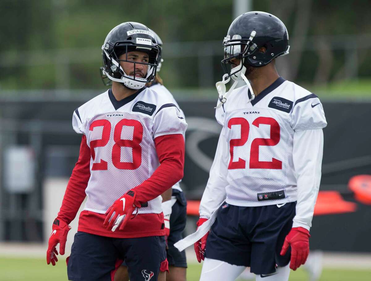 Cornerbacks Xavier Crawford (28) and Aaron Colvin (22) talk to each other during Houston Texans OTA's at the Houston Methodist Training Center on Wednesday, May 29, 2019, in Houston.