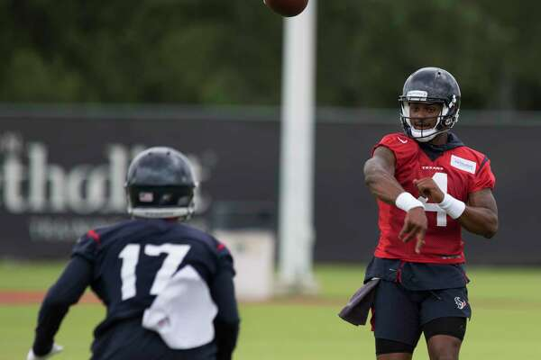 Quarterback Deshaun Watson (4) throws a pass to wide receiver Vyncint Smith (17) during Houston Texans OTA's at the Houston Methodist Training Center on Wednesday, May 29, 2019, in Houston.