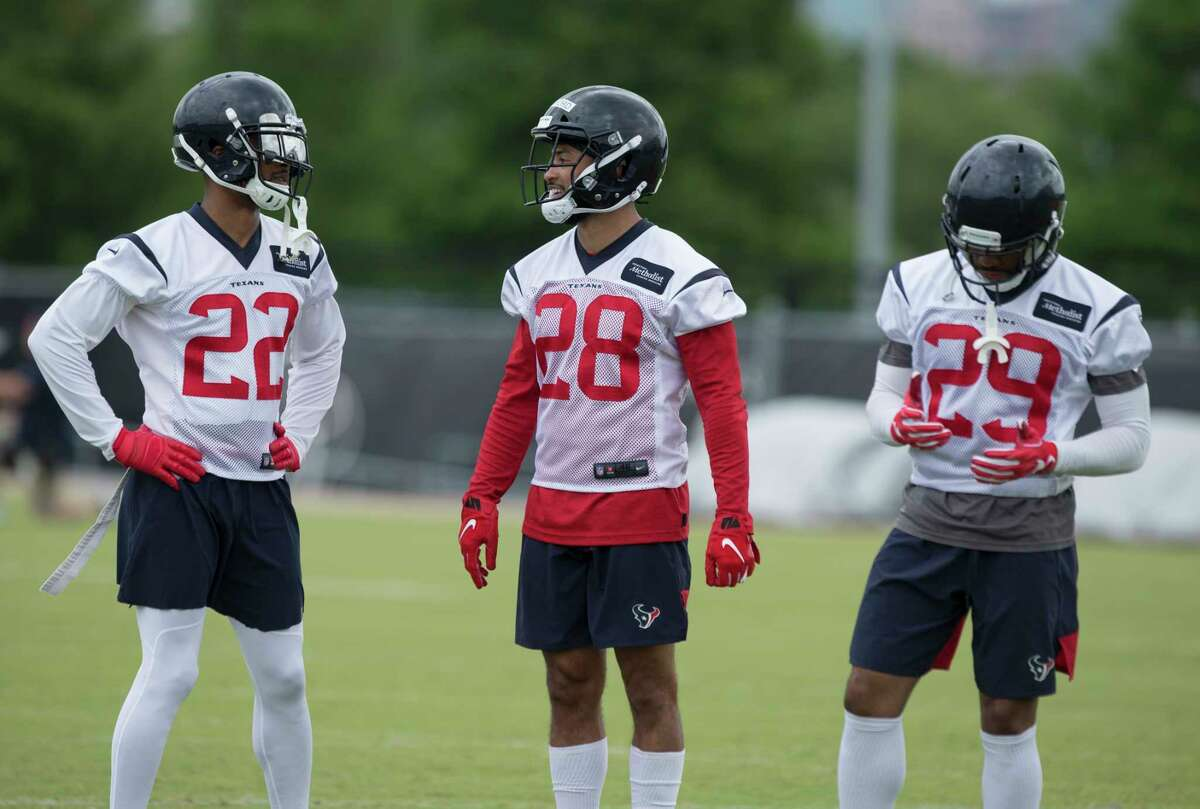 Cornerbacks Aaron Colvin (22), Xavier Crawford (28) and Briean Boddy-Calhoun talk to each other during Houston Texans OTA's at the Houston Methodist Training Center on Wednesday, May 29, 2019, in Houston.