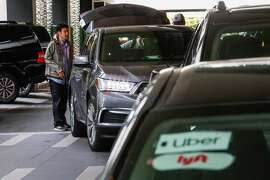 A line of transportation network vehicles at the Hyatt hotel in downtown San Francisco, California, on Monday, May 20, 2019. Author Paul Leigh explains why driving for one of these companies is one of the most dangerous jobs in the country.
