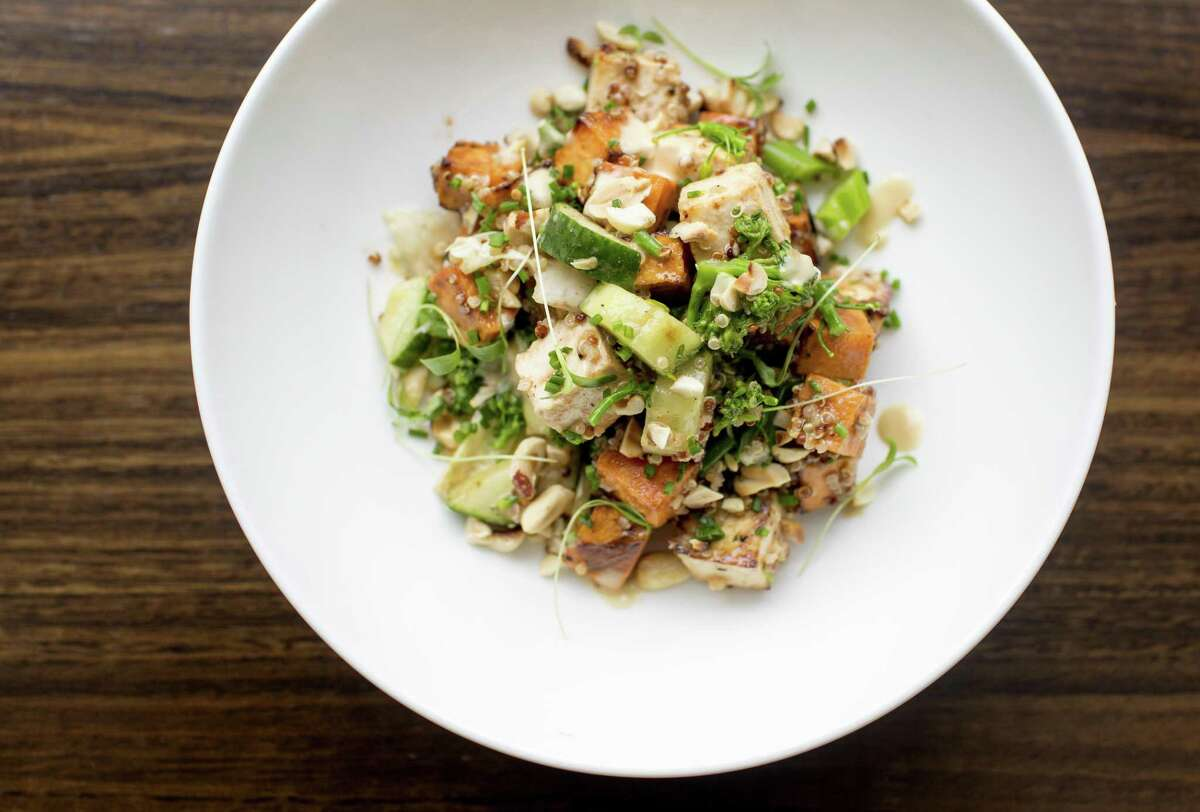 Miso-roasted sweet potatoes and tofu are the savory heart of a quinoa salad served at Third Coast restaurant.