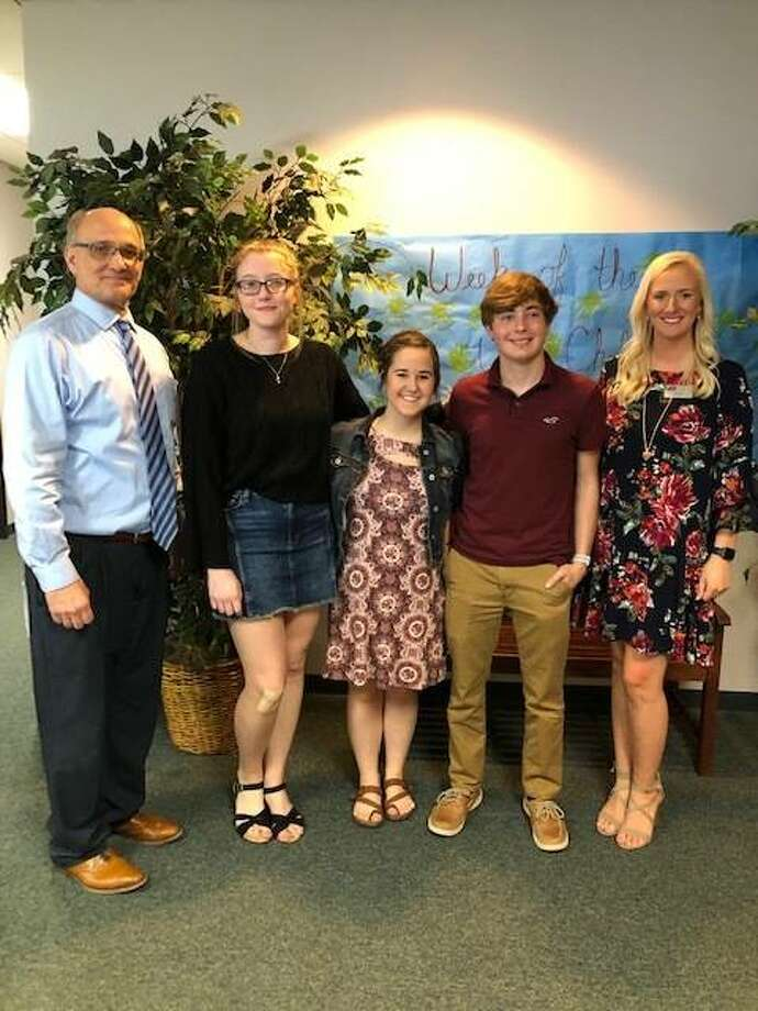 Jersey State Bank recently announced scholarship winners in its community banking essay contact. Pictured from left are Jersey State Bank President/CEO Mark Schaefer, Anna Krashaar, Sally Reed, Jay Goetten and Jersey State Bank Marketing Manager Laura Stemm.