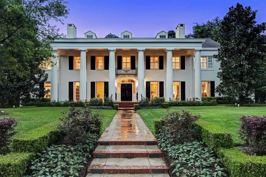 This $6.7 million River Oaks mansion was originally designed by renowned architect Hiram Salisbury. The 9,720 square foot home boasts six to seven bedrooms, six full and one half bathrooms, a study, gourmet kitchen, game room, pool and covered porch with vaulted ceilings. Photo: TK Images/Houston Association Of Realtors