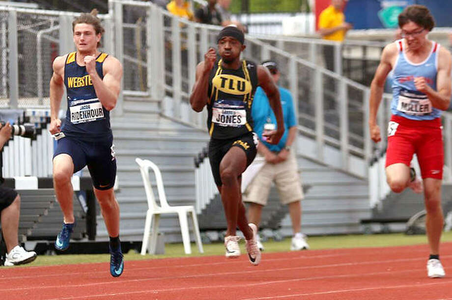 Webster University's Jacob Ridenhour, left, finished second in the 200-meter run and was 11th in the 100-meter dash at the recent NCAA Division III Nationals Championships in Geneva, Ohio. He is shown heading toward the finish line in the 100-meter dash. Photo: Ryan Coleman Photo
