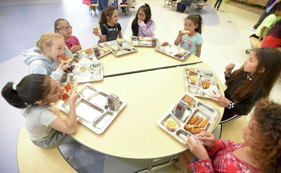 Second graders at New Lebanon School enjoy their lunches on May 17, 2019 in Greenwich, Connecticut. The school piloted metal trays this week, part of an effort by the Green Schools Committee to reduce waste during school lunch. Photo: Matthew Brown, Staff Photographer / Hearst Connecticut Media / Stamford Advocate