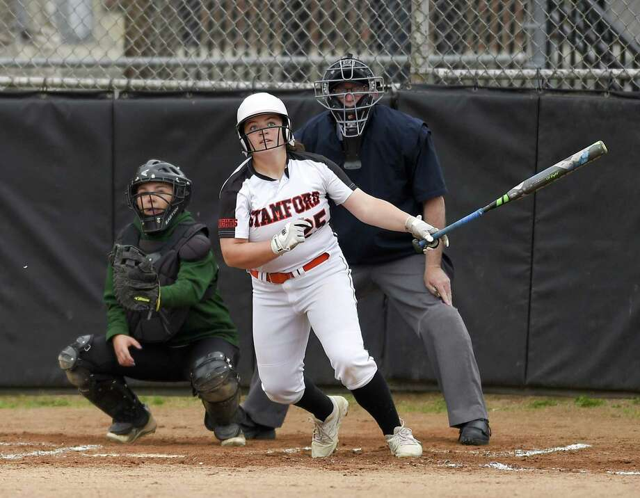 Stamford's Abby Hogan hit a grand slam in the fifth inning against New Milford in the Class LL state tournament in Stamford on Wednesday. Stamford won, 10-0. Photo: Matthew Brown / Hearst Connecticut Media / Stamford Advocate