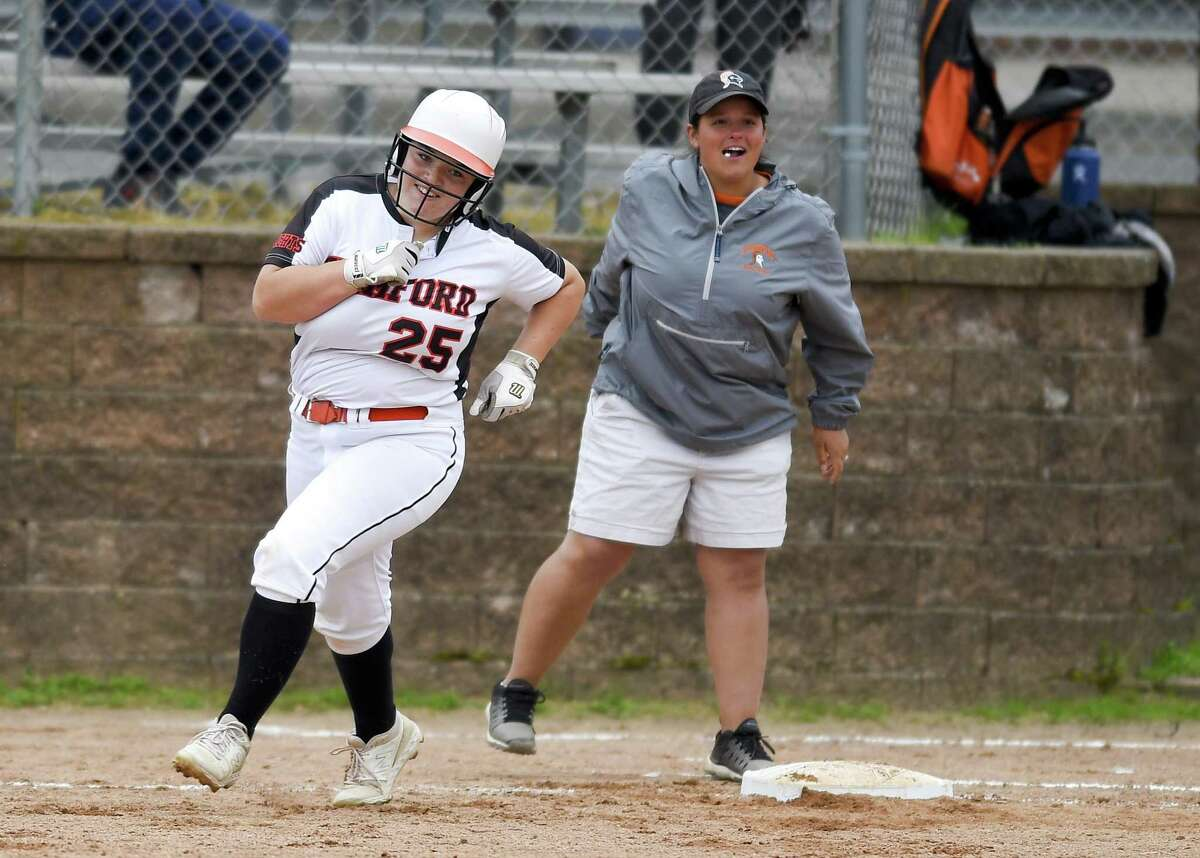 Stamford's Abby Hogan celebrates a fifth-inning grand slam against New Milford in the Class LL state tournament on Wednesday. Host Stamford won, 10-0.