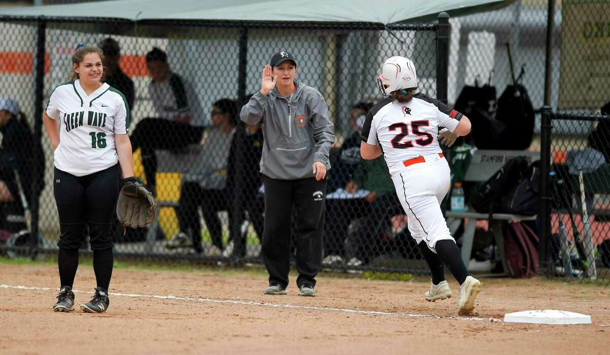 Stamford coach Melissa Giordano celebrates with Abby Hogan following her fifth inning grand slam against New Milford in the CIAC Class LL softball tournament at Stamford High School on May 29, 2019 in Stamford, Connecticut.