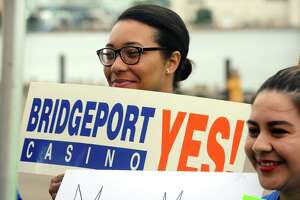 Santa Gonzalez holds a sign in support of a new casino in Bridgeport, Conn. Sept. 18, 2017. MGM Resorts International announced plans to build MGM Bridgeport, a new waterfront casino and entertainment complex in Bridgeport.