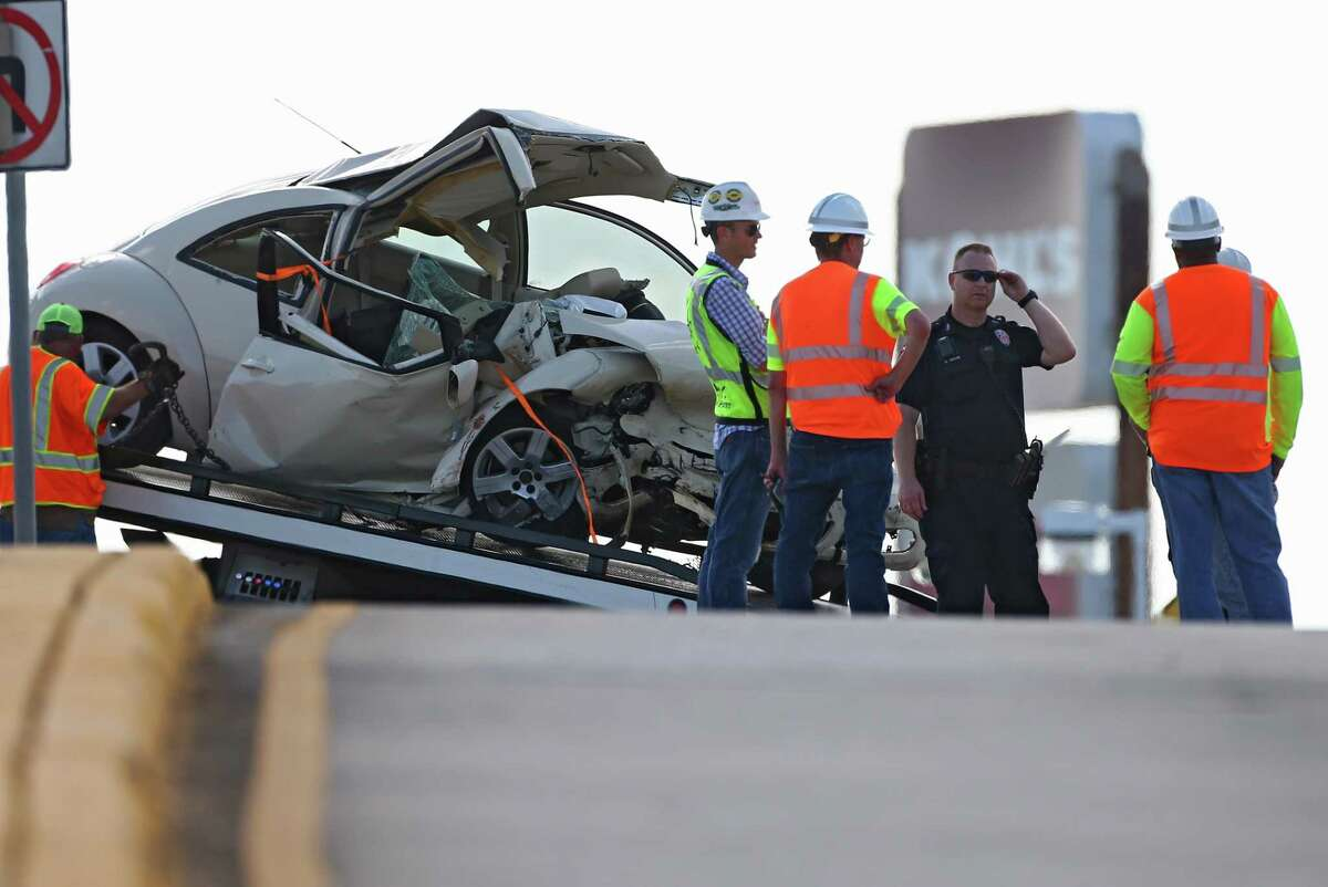 Authorities investigate the scene of single-vehicle crash where two people died on the Interstate 69 HOV off-ramp near Townsen Boulevard on June 12, 2018, in Humble.