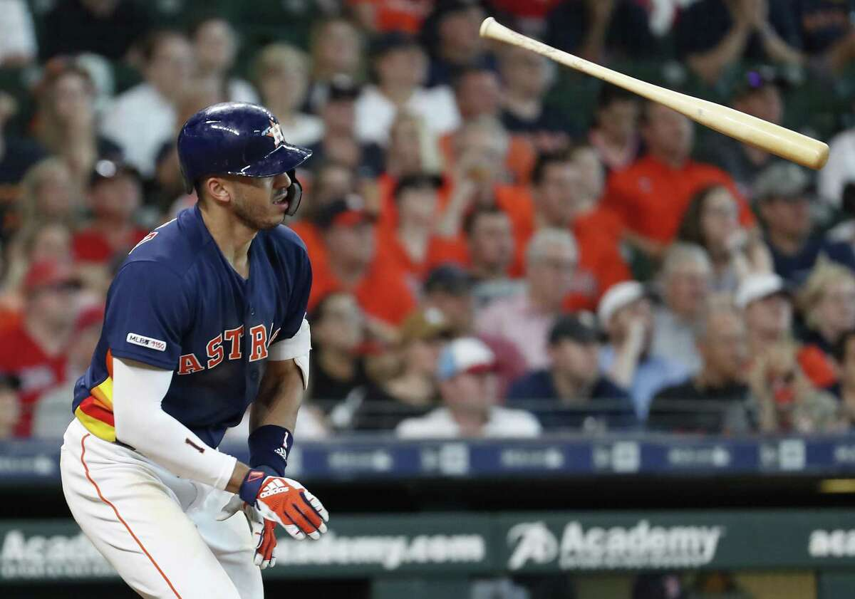 Houston Astros shortstop Carlos Correa flips his bat as he grounds out during the ninth inning of a major league baseball game against the Boston Red Sox at Minute Maid Park on Sunday, May 26, 2019, in Houston.