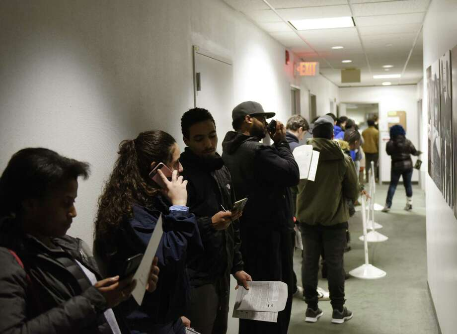 Last-minute voters wait in line to register to vote at the Stamford Government Center in Stamford, Conn. on Election Day, Tuesday, Nov. 6, 2018. Photo: Tyler Sizemore / Hearst Connecticut Media / Greenwich Time