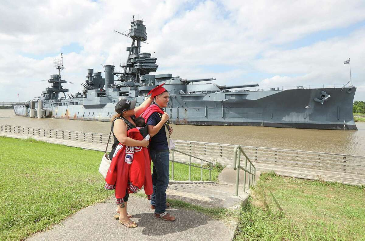 MacArthur High School graduate Daniel C. Herrera has help adjusting his cap by his mother, Lidia Herrera, during his photo session in front of the Battleship Texas Wednesday, May 29, 2019, in La Porte. Herrera has enlisted in the Navy and will ship out June 20th. The Battleship Texas will move from its historic site at the San Jacinto Battleground near La Porte, the head of the nonprofit that oversees the vessel said.
