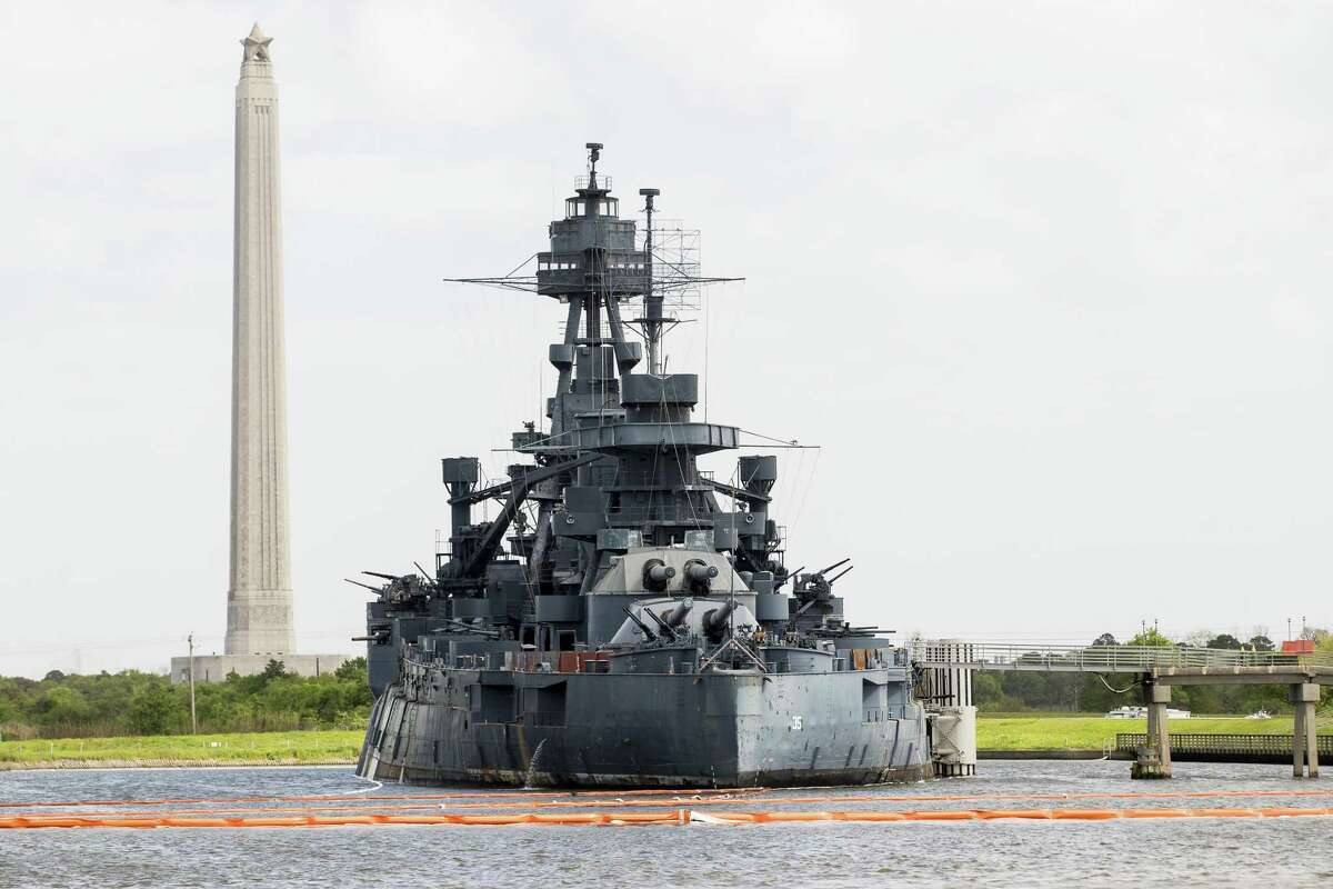 Containment buoy stretches across the water to protect the Battleship Texas as cleanup continues along the Houston Ship Channel in the aftermath of the tank fire at Intercontinental Terminals Company on Friday, March 29, 2019, in Deer Park.