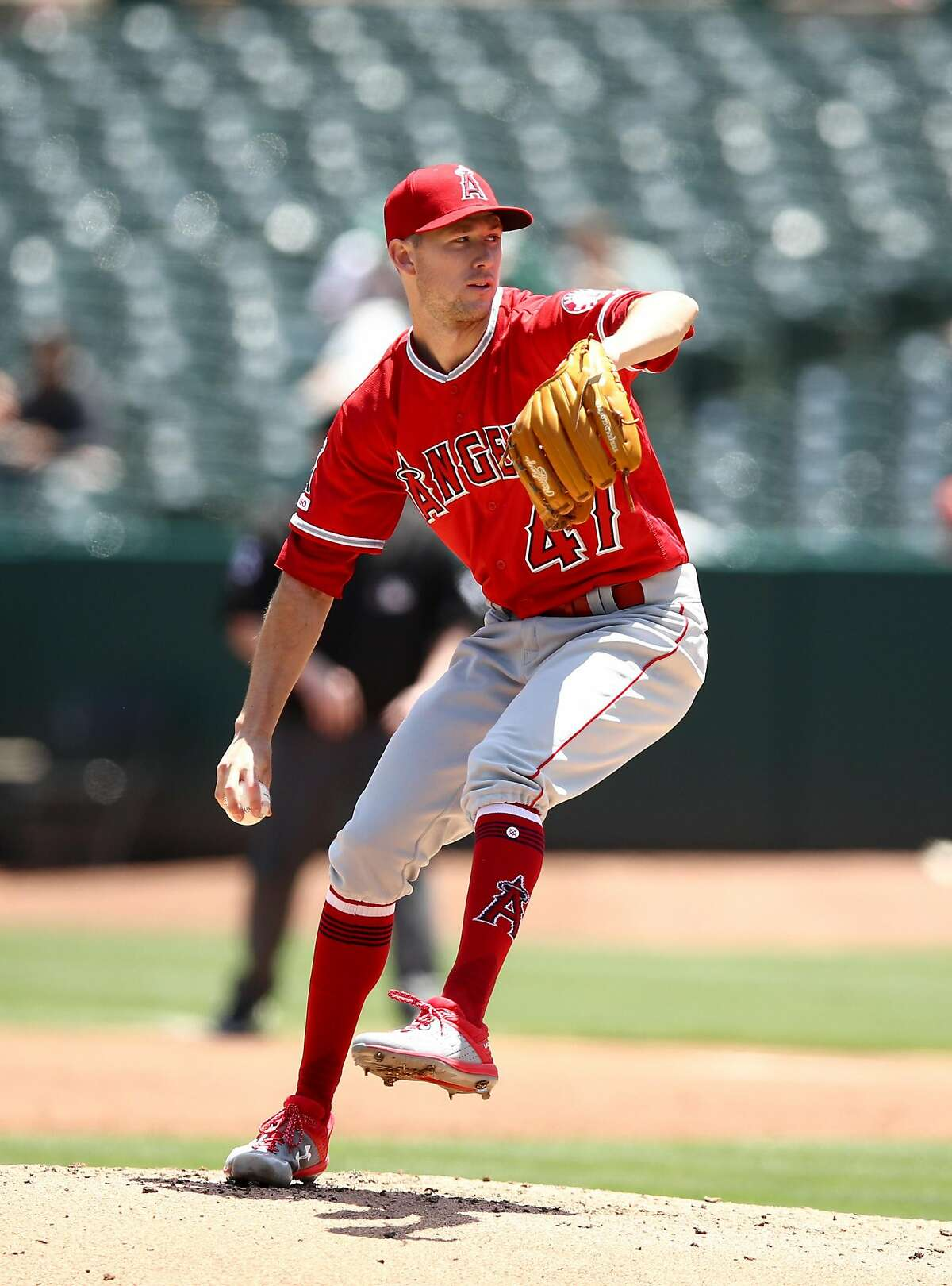 OAKLAND, CALIFORNIA - MAY 29: Griffin Canning #47 of the Los Angeles Angels pitches against the Oakland Athletics in the first inning at Oakland-Alameda County Coliseum on May 29, 2019 in Oakland, California. (Photo by Ezra Shaw/Getty Images)