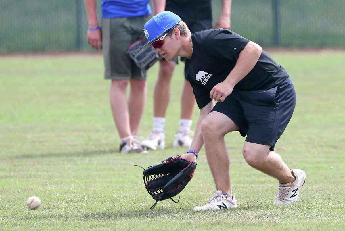 La Vernia baseball player Koy Carpenter grabs a ground ball Tuesday, May 28, 2019 during fielding drills at the team's baseball field. La Vernia plays in the regional finals against Liberty Hill on June 1.