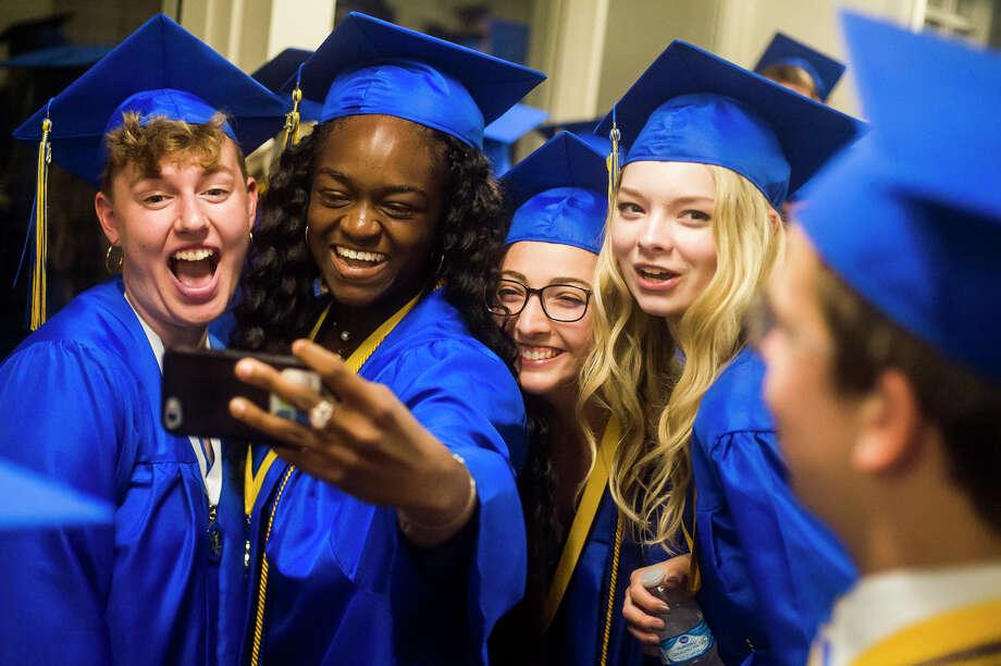 Midland High School seniors celebrate graduation during their commencement ceremony on Wednesday, May 29, 2019 at Dow Diamond. (Katy Kildee/kkildee@mdn.net) Photo: (Katy Kildee/kkildee@mdn.net)