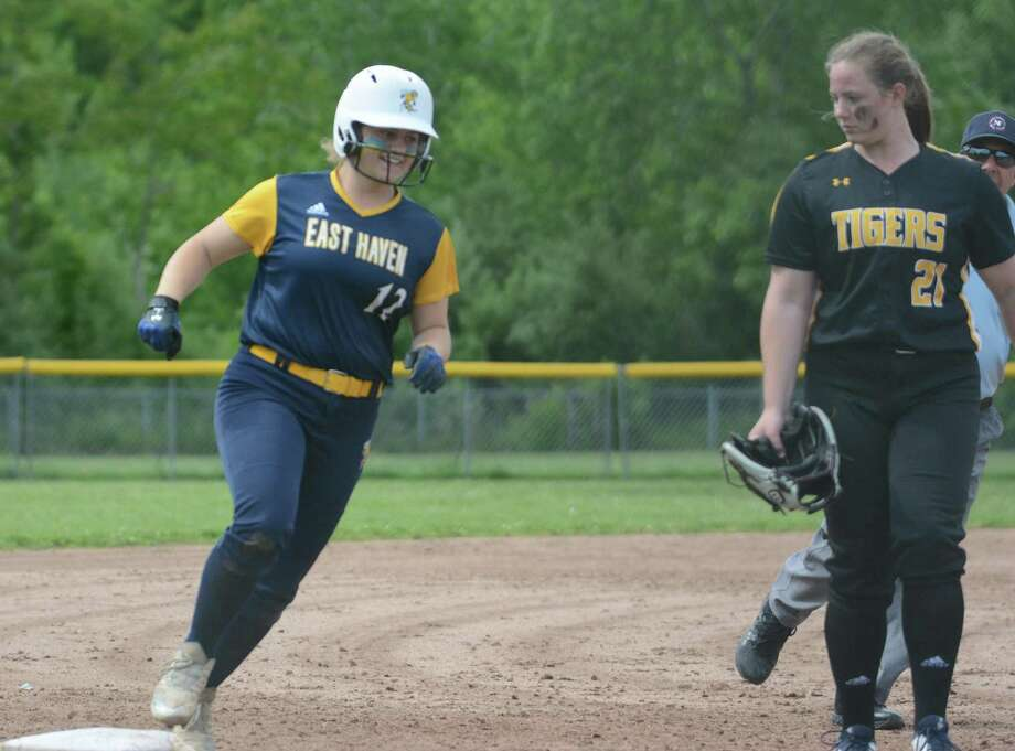 East Haven's Becky Flynn rounds third base after hitting a game-winning homer. Photo: Dave Phillips / For Hearst Connecticut Media