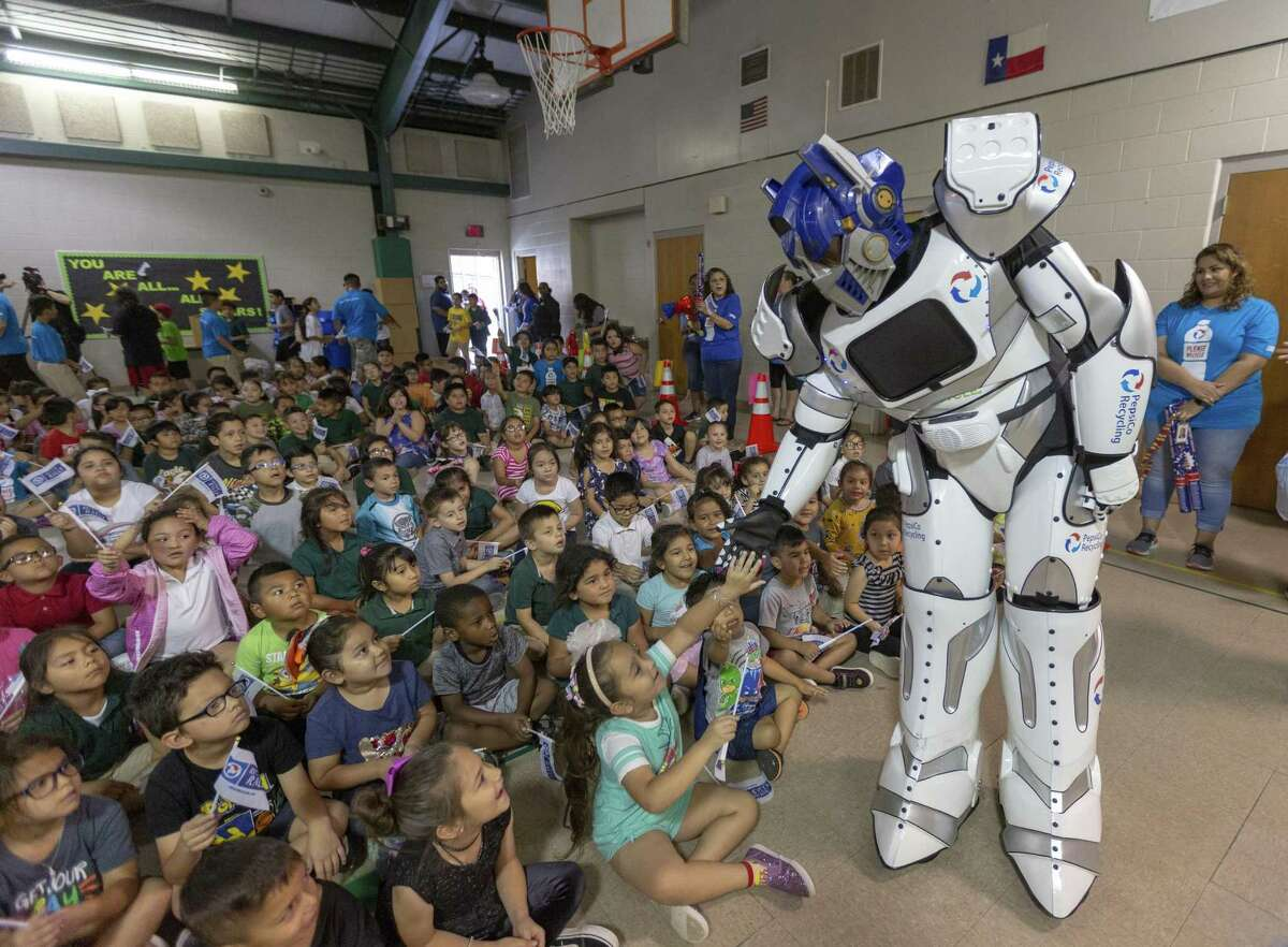 A robot mascot supporting Pepsi's Recycle Rally recycling contest greets students Wednesday, May 29, 2019 at Arnold Elementary School during a rally in which is was announced Arnold won first place in the nationwide contest. The students collected 3.2 million pounds of recycling to beat 6,000 other school and win $50,000 from Pepsi, according to Pepsi.