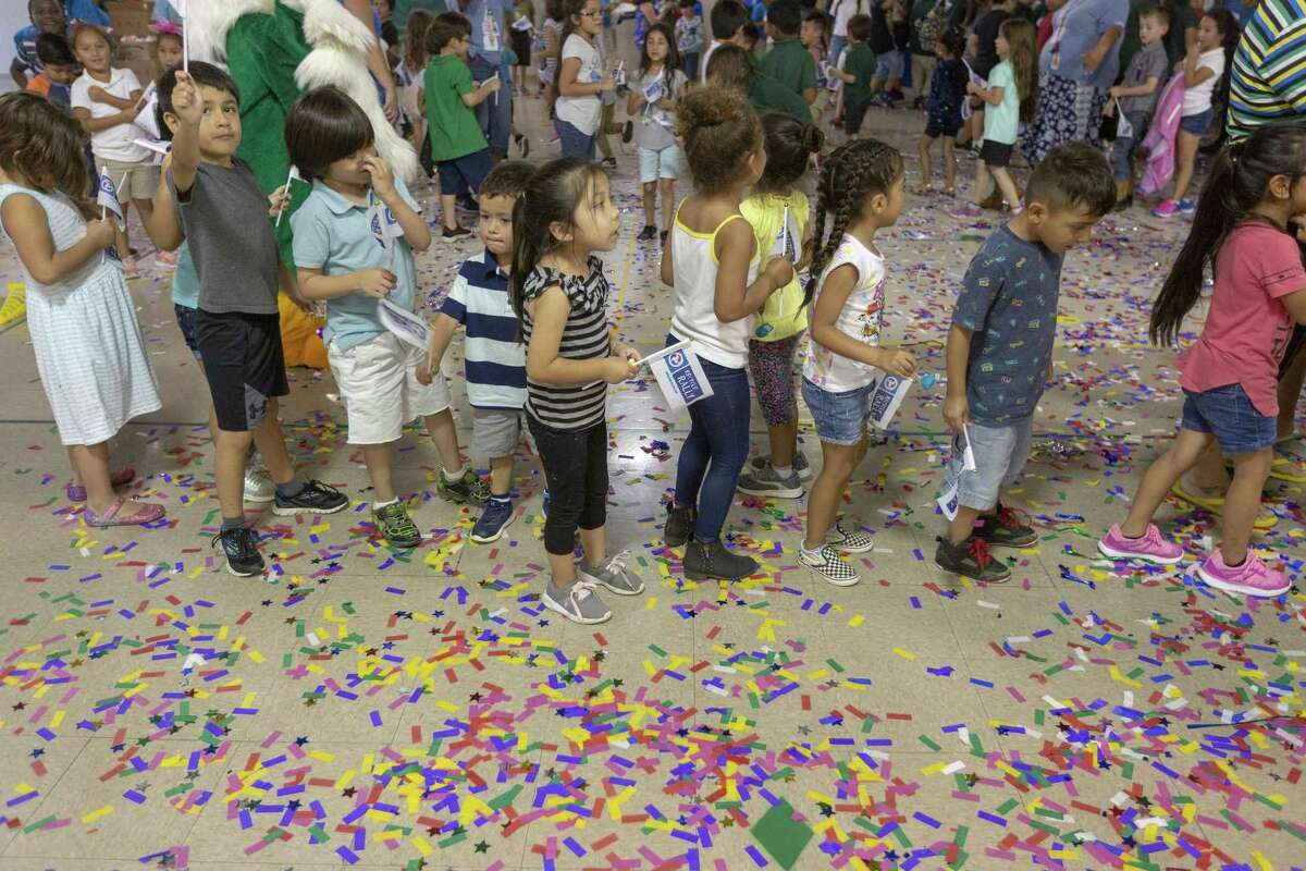 Arnold Elementary School students make their way Wednesday, May 29, 2019 through confetti in the school's gym after it was announced the school won first place and $50,000 from Pepsi for collecting 3.2 million pounds of recycling as part of Pepsi's Recycle Rally national recycling challenge for school.