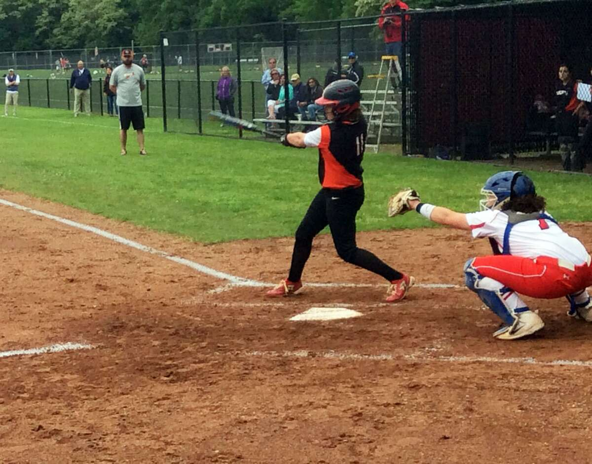 Ridgefield's Skylar Arent drives in two runs with a hit against Greenwich in the Class LL tournament.