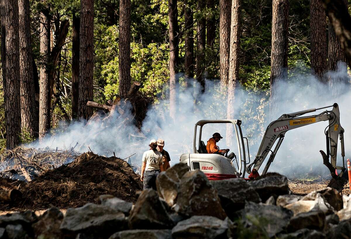 Smoke rises from a controlled burn operation in Yosemite Valley at Yosemite National Park in Yosemite, Calif. Tuesday, May 28, 2019.