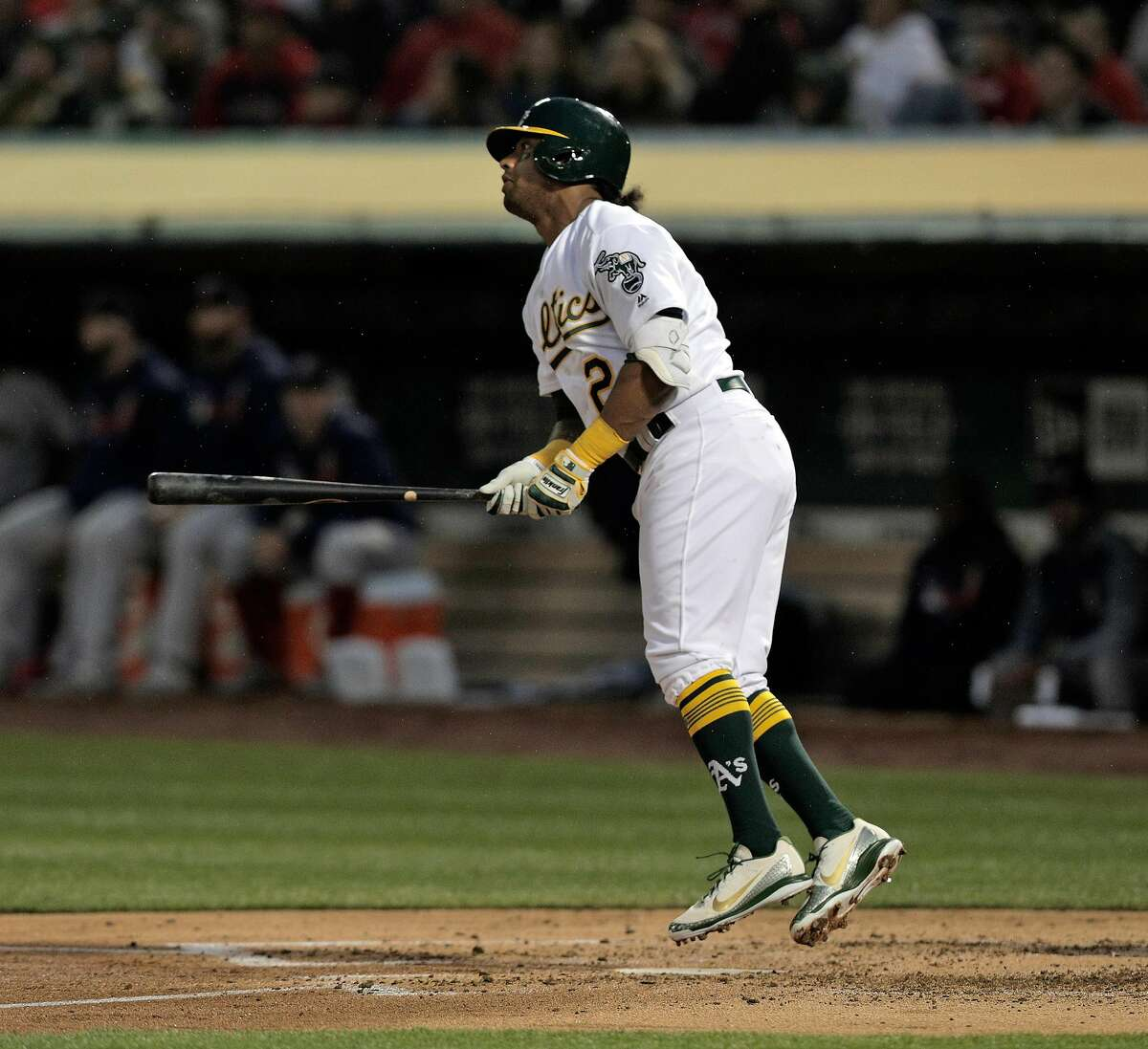 Khris Davis (2) hops up as he watches his solo homerun in the second inning as the Oakland Athletics played the Boston Red Sox at the Coliseum in Oakland, Calif., on Monday, April 1, 2019.