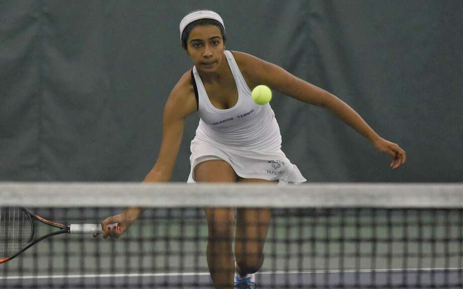Wilton's Rhea Raghavan charges the net at No. 4 singles during the Warriors' match against Darien in the CIAC Class L tennis quarterfinals at the Solaris Racquet Club in Stamford on Wednesday. Photo: Dave Stewart / Hearst Connecticut Media / Hearst Connecticut Media