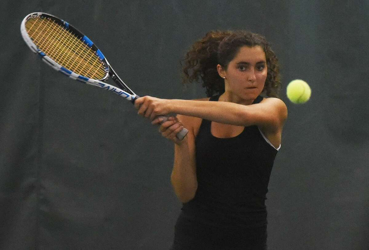 Darien's Cameron Cavanna hits a backhand shot at No. 3 singles during the Blue Wave's match against Wilton in the CIAC Class L quarterfinals at the Solaris Racquet Club in Stamford on Wednesday.