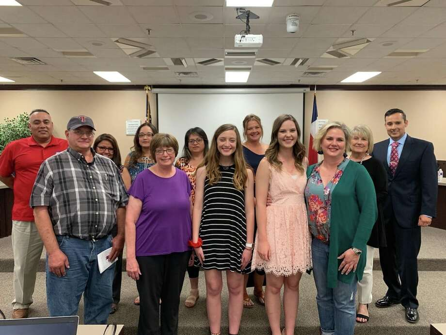 Jesse Long and Amanda Holt stand with their parents after being recognized as a recent Plainview ISD School Board meeting. Photo: Plainview ISD/Courtesy Photo