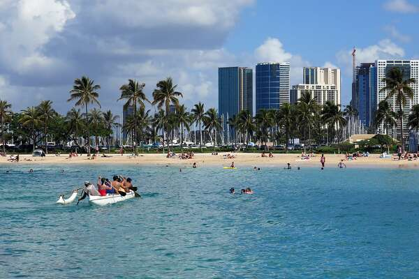 """FILE - This May 21, 2014, file photo shows Duke Kahanamoku Beach in the Honolulu tourist neighborhood of Waikiki in Hawaii. Stephen Leatherman, a coastal scientist and professor at Florida International University, has been drafting a list of the best beaches in the U.S. under alias """"Dr. Beach"""" since 1991. This year he has named Duke Kahanamoku Beach the fifth-best in the country. (AP Photo/Sam Eifling, File)"""