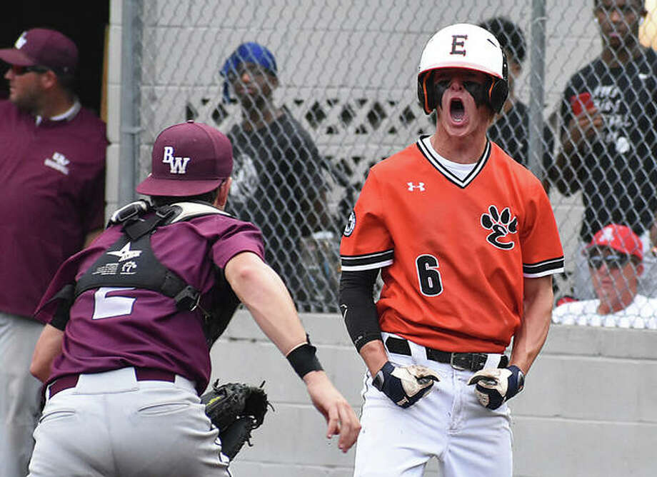 Edwardsville's Hayden Moore celebrates after scoring the first run of the game in the third inning on Wednesday in the Class 4A Illinois Wesleyan Sectional semifinals at Blazier Field in O'Fallon. Photo: Matt Kamp | For The Telegraph