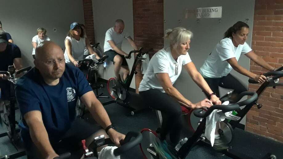 The Torrington Fire Department and the City of Torrington faced off Wednesday in a fitness challenge, raising money for local youth sports programs. City employees led by Mayor Elinor Carbone and firefighters led by member Mike Farrell rode stationery bikes at Odyssey Group Fitness, inside the Energy Fitness complex at 59 Field St. Photo: Emily M. Olson / Hearst Connecticut Media /