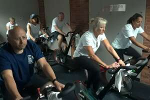 The Torrington Fire Department and the City of Torrington faced off Wednesday in a fitness challenge, raising money for local youth sports programs. City employees led by Mayor Elinor Carbone and firefighters led by member Mike Farrell rode stationery bikes at Odyssey Group Fitness, inside the Energy Fitness complex at 59 Field St.